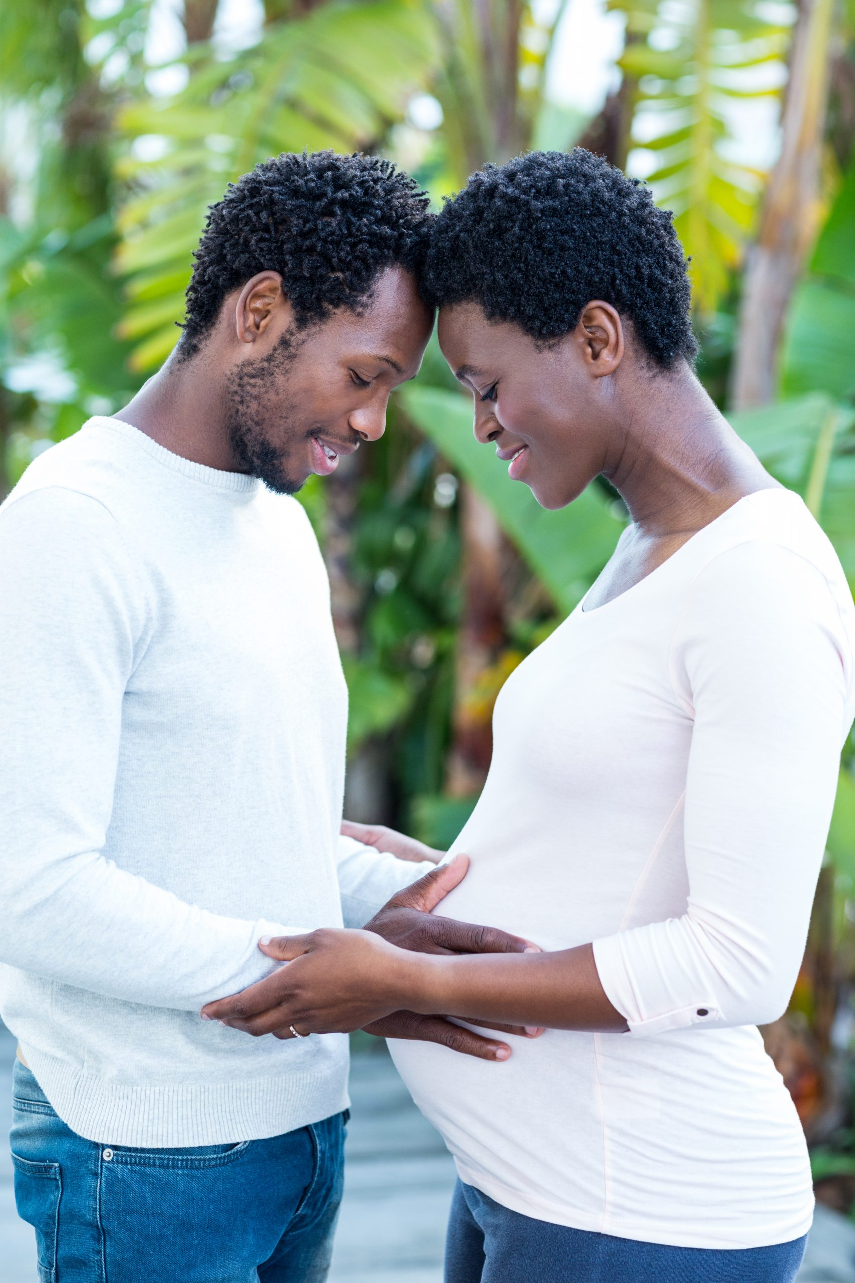 man touching pregnant wife's belly